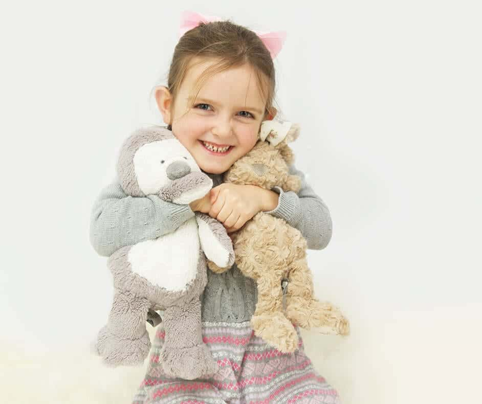 Young girl with soft toys